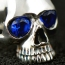 Skull ring with blue stones