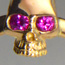 Golden skullring with rubys